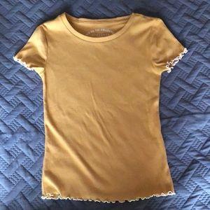 Cute mustard colored shirt!